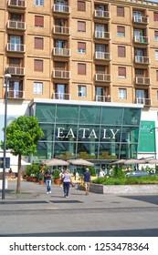 MILANO, ITALY - JUNE, 2018: Local Milanese people walking into the entrance of Eataly Milano Smeraldo.