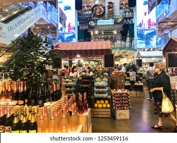 MILANO, ITALY - JUNE, 2018: Milanese people shopping for groceries at Eataly Milano Smeraldo, the world's largest Italian marketplace.