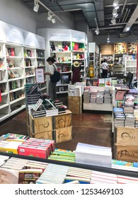 MILANO, ITALY - JUNE, 2018:  People shopping in the bookstore department in Eataly marketplace.