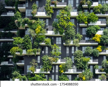 Milano, Italy. June 5, 2020. Bosco Verticale, a close up view at the modern and ecological skyscrapers with many trees on each balcony. Modern architecture, vertical gardens, terraces with plants