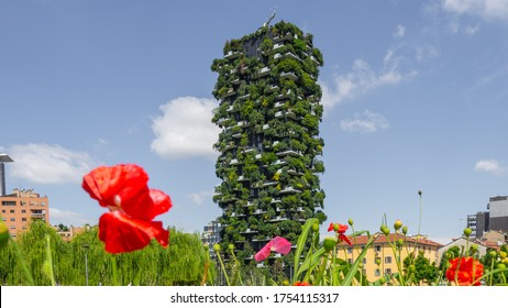 Milano, Italy. June 5, 2020. Bosco Verticale, view at the modern and ecological skyscraper with many trees on each balcony. Modern architecture, vertical gardens, terraces with plants