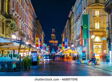 MILANO, ITALY, MARCH 13, 2016: night view of the illuminated via dante street in milano with castello sforzesco at ist very end.