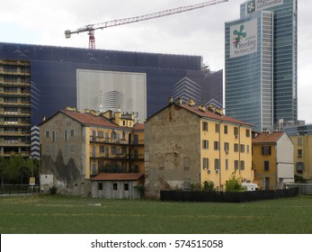 MILANO, ITALY - NOVEMBER, 2016: Old buildings surviving amidst modern skyscrapers of the new (2012) architectural complex in Centro Direzionale, around the Piazza named after architect Gae Aulenti.