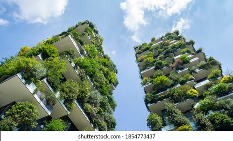 Milano, Italy. November 5, 2020. Bosco Verticale, view at the modern and ecological skyscraper with many trees on each balcony. Modern architecture, vertical gardens, terraces with plants