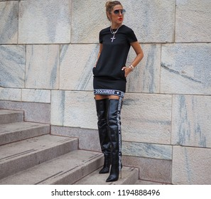 MILANO, Italy: September 21, 2018: Fashionable woman in street style outfit on Arengario stairs after ACT 1 fashion show during MFW fall/winter 2018/2019.2018/2019.