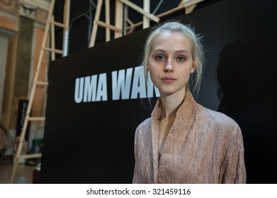 MILANO, ITALY - SEPTEMBER 25, 2015: a model photographed at the backstage of Uma Wang during the presentation of spring-summer 15/16 collection at Milan Fashion Week 2015.
