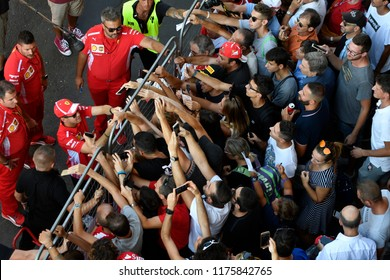 MILANO, ITALY-AUGUST 29, 2018: Ferrari's Formula 1 driver, Sebastian Vettel, signs autographs to the fans, during the F1 Milan Festival, 2018, in Milan.