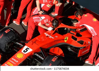 MILANO, ITALY-AUGUST 29, 2018: Ferrari's Formula 1 driver, number 5 of Sebastian Vettel, with pit stp crew, during the F1 Milan Festival, 2018, in Milan.