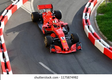 MILANO, ITALY-AUGUST 29, 2018: top view Ferrari's Formula 1 driver, Sebastian Vettel, driving on the city circuit, during the F1 Milan Festival, 2018, in Milan.