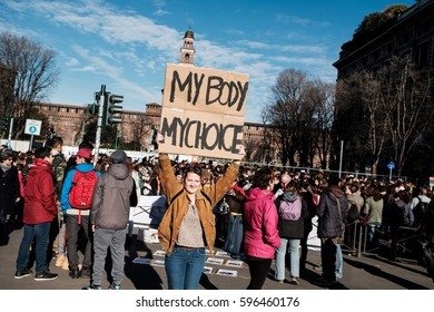 MILANO,  MARCH 08, 2017:  A girl with a sign before the start of the march for the International Women's Day