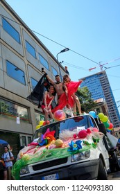 Milano Pride 2018, manifestation of gay, lesbians, asexuals, bisexuals, intersexual and queer pride. Man and two transgenders dancing over a car. Milan, Italy. June 30, 2018.