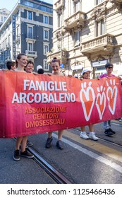 Milano Pride 2018, manifestation of gay, lesbians, asexuals, bisexuals, intersexual and queer pride. People holding a band during the start of the parade. Milan, Italy. June 30, 2018.