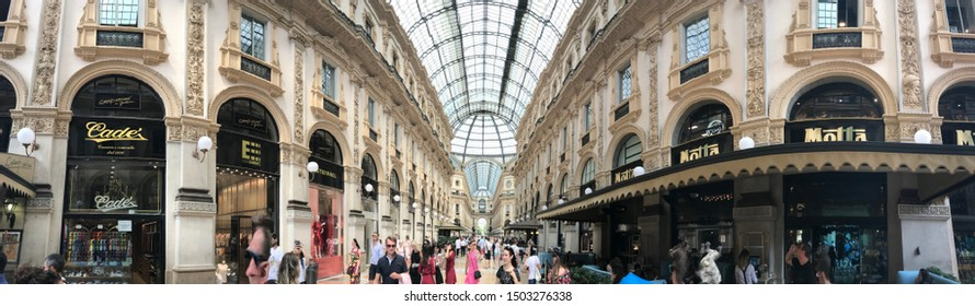 Milano/Italy 2. July 2019: Galleria Vittorio Emanuele II Panoramic picture of this great shopping center in Milano. Exclusive and luxury shops on every corner, people everywhere Editorial