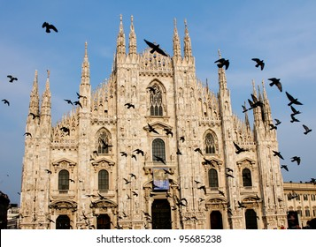 Milan's Cathedral with flying pigeons