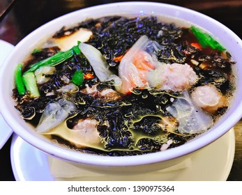 Mild soup with seaweed and minced pork in Thailand.