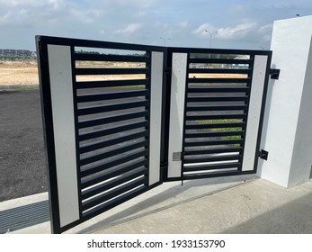 mild steel folding gate with timber plank