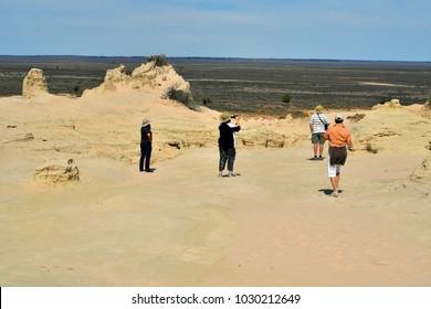 MILDURA, NSW, AUSTRALIA - NOVEMBER 09: Unidentified tourists by sightseeing in Mungo National Park in New South Wales, on November 09, 2017 in Mildura, Australia