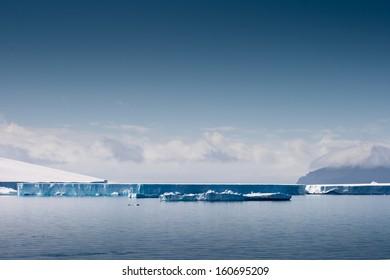 Mile long icebergs on the horizon, Antarctica