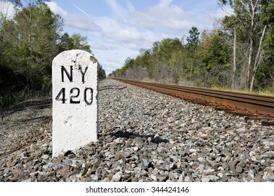 Mile marker 420 on the former rail line running between New York City and Buffalo, NY. This line has been in place since the early 1900s. No information on how long this marker has been in place.