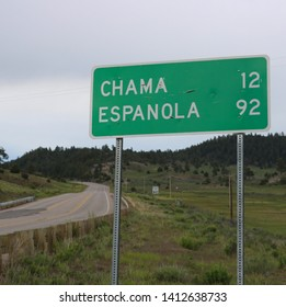Mileage Sign: Chama, NM 12 Miles / Espanola, NM 92 Miles at the Junction of U.S. Hwy 64 and U.S. Hwy 84, New Mexico/USA (May 30, 2019)