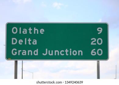 Mileage Sign: Olathe, CO 9 Miles / Delta, CO 20 Miles / Grand Junction 60 Miles (March 24, 2019)