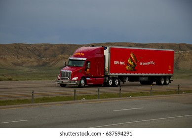 Mile-Hi Transport / Trucking A red Peterbilt tractor pulls a red Mcdonald's trailer.  May 7th, 2017 Rock Springs, Wyoming, USA