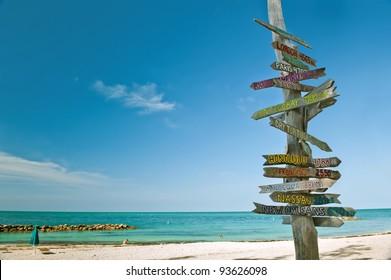 milepost on beach in key west florida