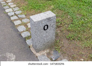 Milestone granite stone marker border sign distance mile kilometer