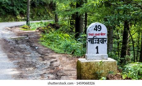 milestone showing distance to khajjiar (written in hindi), Dalhousie