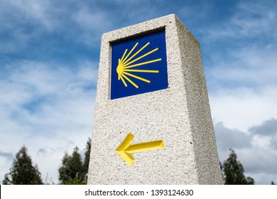 Milestone sign of Camino de Santiago. Pilgrimage sign to Santiago de Compostela