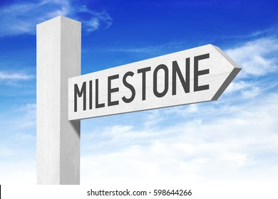 Milestone - white wooden signpost with one arrow