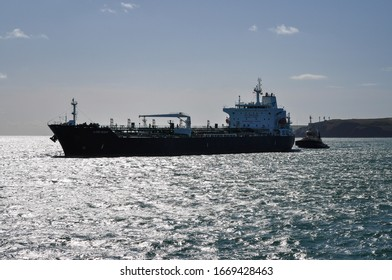 Milford Haven, Pembrokeshire, Wales - August 31, 2019: Product tanker Alpine Meadow being escorted into Milford Haven by the escort tug Svitzer Caldey.