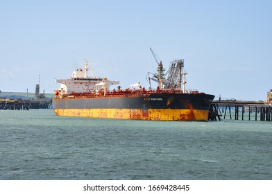 Milford Haven Puma Storage Terminal, Pembrokeshire, Wales - August 31, 2019:  Crude Oil tanker Front Panther discharging cargo.