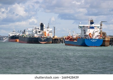 Milford Haven Valero Terminal, Pembrokeshire, Wales - August 31, 2019: Product tankers Bro Developer, Energy Chancellor and Crude oil tanker Star Swift undertaking cargo operations at Valero Terminal.
