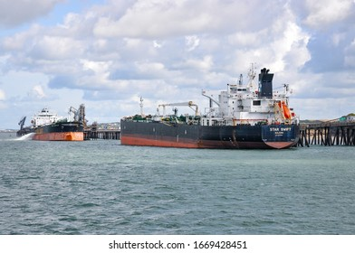 Milford Haven Valero Terminal, Pembrokeshire, Wales - August 31, 2019: Product tanker Energy Chancellor and Crude oil tanker Star Swift undertaking cargo operations at Valero Terminal.