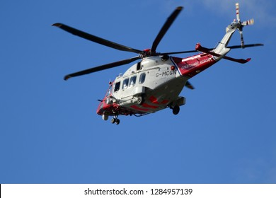 MILFORD ON SEA, LYMINGTON, ENGLAND, UK. NOVEMBER 19, 2018.  Coastguard AugustaWestland AW189 Helicopter flies over Hurst Castle on the way to the Isle of Wight.