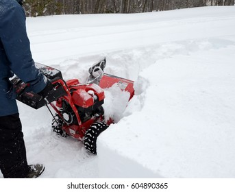 MILFORD, PA- MARCH 20, 2017: Closeup of a man with a snowblower in the after effects of blizzard Stella dropping over 20 inches of snow in the Poconos of Pennsylvania on March 14, 2017