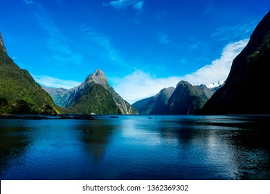 Milford Sound in New Zealand is considered one of the great wonders of the world because of how beautifully the land has been carved by glaciers.