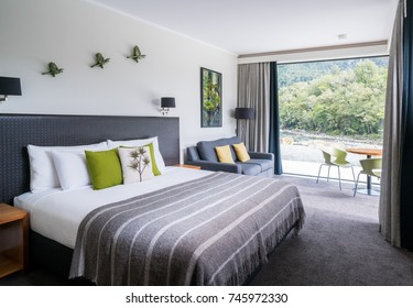 Milford Sound, New Zealand - Dec 7, 2016: Luxury bedroom interior decoration with nature scenic window look out at Milford Sound Lodge, accommodation in Milford Sound, Fiordland, New Zealand.