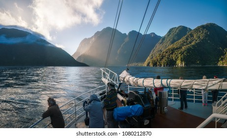 Milford Sound, New Zealand -December 22, 2017: People enjoying a Cruise ride early in the morning at Milford Sound in Fiordland National Park, New Zealand, South Island.