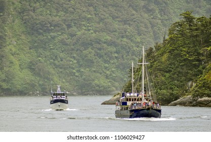 "Milford Sound, New Zealand - December 24 2010: Tour boats ""Milford Wanderer"" and ""Sinbad"" round Dale Point, after a trip out into the stormy waters of the Tasman Sea, just to give their guests a taste"