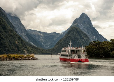 "MILFORD SOUND, NEW ZEALAND - FEBRUARY 14: Tour boat cruises out into Milford Sound on February 14, 2012 in Fiordland. Milford Sound was described as ""the eight wonder of the world"" by Rudyard Kipling."