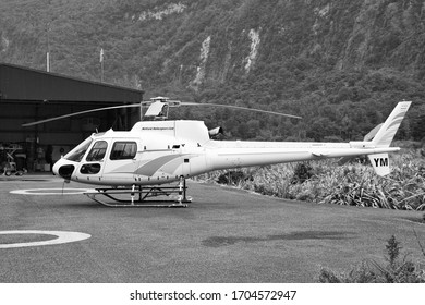 MILFORD SOUND, NEW ZEALAND - FEBRUARY 26: Eurocopter AS350 parked on February 26, 2008 in Milford Sound, New Zealand. AS350 is on of most successful helicopters ever (5000+ produced).