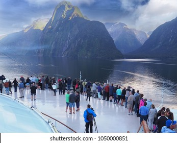 MILFORD SOUND, NEW ZEALAND - JANUARY 21, 2018: View from the deck of the Sun Princess cruise ship as it sails into Milford Sound in the New Zealand Fiordland National Park.