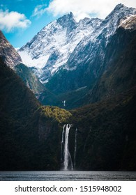 Milford Sound in south Island New Zealand, with snowy peaks and waterfalls