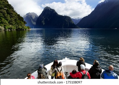 MILFORD SOUND,NZ - JAN 14:Visitors sail in Milford Sound on Jan 14 2014.It has been judged the world's top travel destination in the 2008 Travelers Choice Destinations Awards by TripAdvisor.