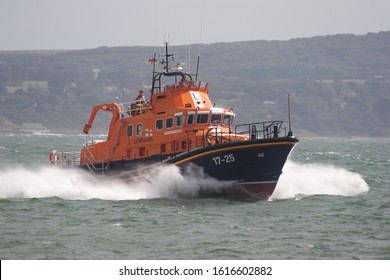 Milford-on-Sea, UK 08/27/2006: Volunteers from the RNLI in action abroad their Severn Class lifeboat