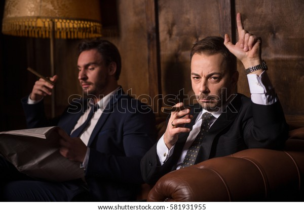 Militant businessman ready to strike. Handsome men spending time in men's club. People ready for battle with global business world.