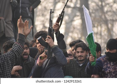 Militant Offered gun-Salute to his slain Associate Azad Malik alias Dada Malik  during his Funeral Processions at his native village Arwani area of South kashmir's Anantnag on 23/11/2018.
