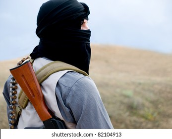 militant with rifle